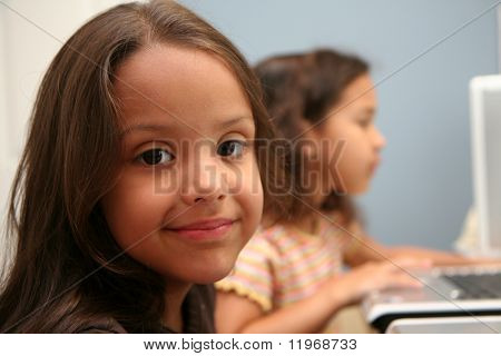 Children on computers at school