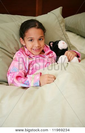 Girl laying in her bed ready to go to sleep