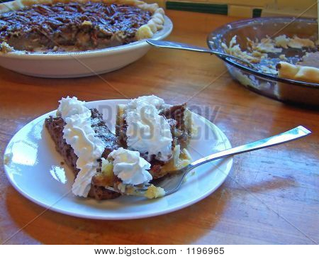 Slices Of Pumpkin Pie And Chocolate Pie