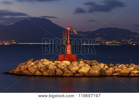 Naples lighthouse at night. Naples, Campania, Italy.