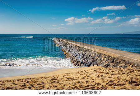 Breakwater, sky, sea and beach