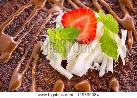 Tasty Chocolate Cake With Glaze And Strawberry On White Chocolate Decoration,  Close Up