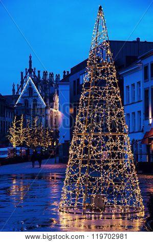 Christmas tree on Veemarkt in Mechelen. City Hall in the back. Mechelen Flemish Region Belgium ** Note: Visible grain at 100%, best at smaller sizes