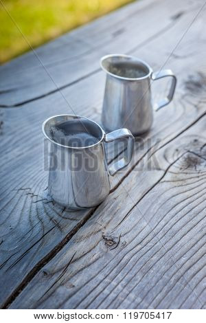 Small Milk Jug On Old Wooden Table