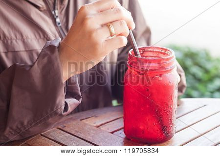 Iced Drink In Red Glass On Wooden Table