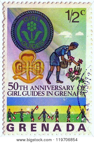 Grenada - Circa 1976: A Postage Stamp Printed In Grenada Showing An Image Of Girl Guides, Series 50