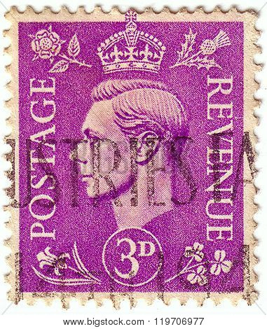 United Kingdom - Circa 1937 To 1947: An English Three Pence Violet Postage Stamp Showing Portrait Of