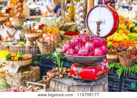 Fruit market with old scales and garnet in Campo di Fiori, Rome