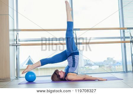 Pilates woman stability ball exercise workout at gym indoor