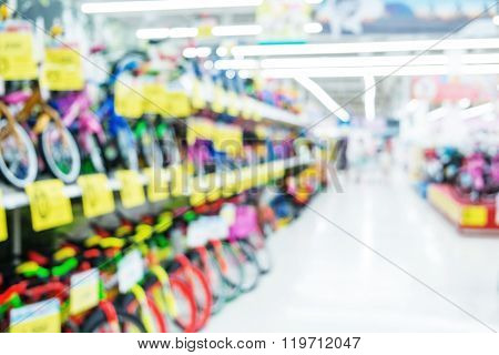 Blurred, defocus shopping mall, kids bicycles