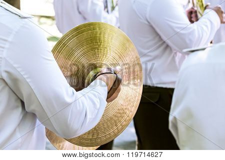 Military Musician Plays Cymbal At The Festival Of Brass Bands