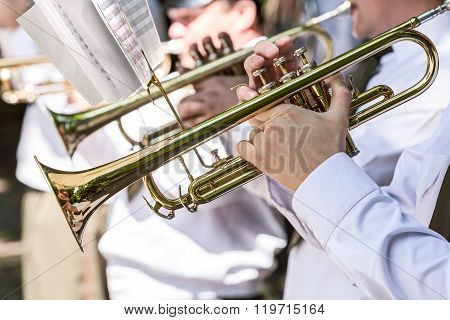 Military Musicians Playing Gold Trumpets On Music Festival