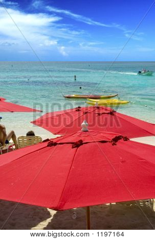 Red Umbrellas On Beach