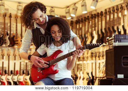 Couple Playing Electric Guitar