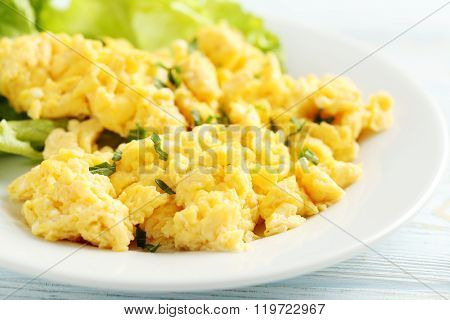 Scrambled Eggs With Vegetables On A Blue Wooden Table