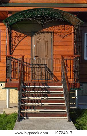 Front Steps With Wrought-iron Fence Closeup