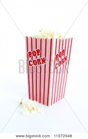 Red popcorn tub overflowing on white background