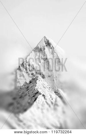 Mountain Peak With Snow In Mist