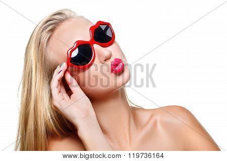 Girl in lips shaped sunglasses