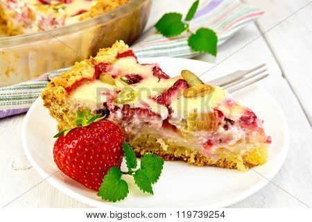Pie strawberry-rhubarb with cream in white plate