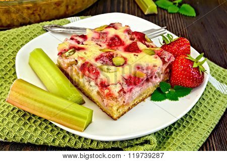 Pie strawberry-rhubarb with cream on green napkin