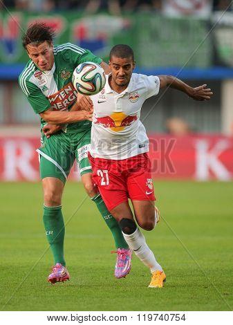 VIENNA, AUSTRIA - SEPTEMBER 28, 2014: Alan (#27 Salzburg) and Stefan Schwab (#8 Rapid) fight for the ball in an Austrian soccer league game.