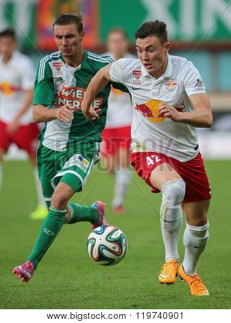 VIENNA, AUSTRIA - SEPTEMBER 28, 2014: Mario Pavelic (#22 Rapid) and Nils Quaschner (#42 Salzburg) fight for the ball in an Austrian soccer league game.