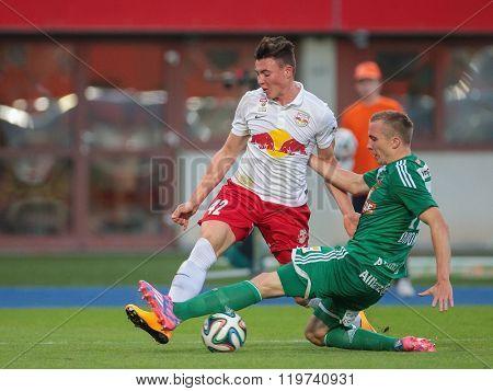 VIENNA, AUSTRIA - SEPTEMBER 28, 2014: Christopher Dibon (#17 Rapid) and Nils Quaschner (#42 Salzburg) fight for the ball in an Austrian soccer league game.