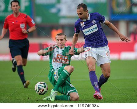 VIENNA, AUSTRIA - NOVEMBER 9, 2014: Omer Damari (#16 Austria) and Stefan Stangl (#23 Rapid) fight for the ball in an Austrian soccer league game.
