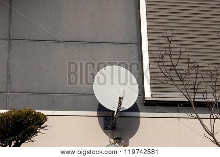 Satellite Antenna On The Wall
