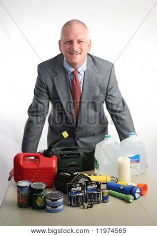 A meteorologist displaying hurricane supplies