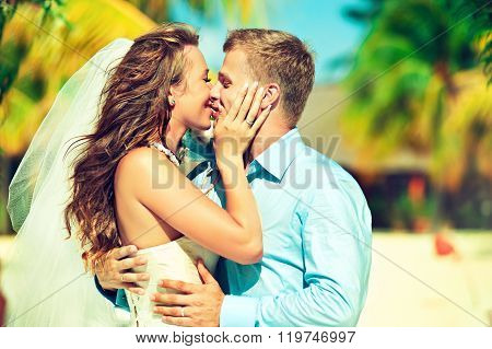Young beautiful couple get married on a tropical island .