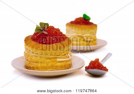 Tartlets with red caviar on white background.