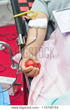 Blood Donor Making Donation With A Bouncy Ball Holding In Hand