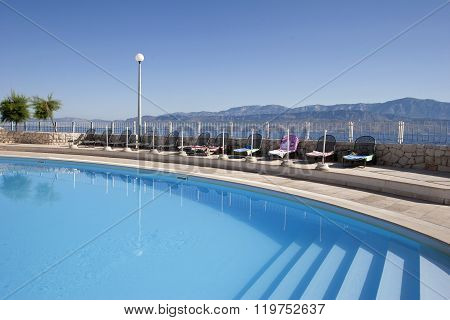 Turquoise blue water in swimming pool