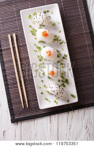 Japanese Food Onigiri Rice Balls On A Plate. Vertical Top View