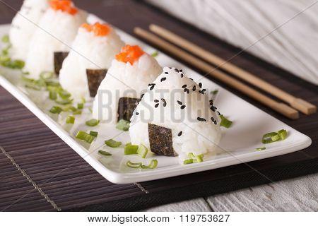 Onigiri Rice Balls With Salmon And Sesame Close-up. Horizontal