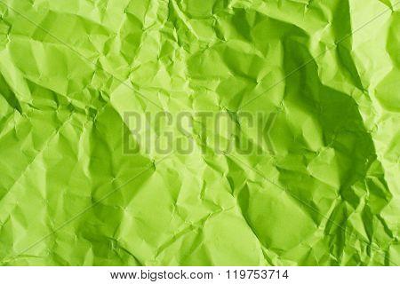 Crumpled green paper