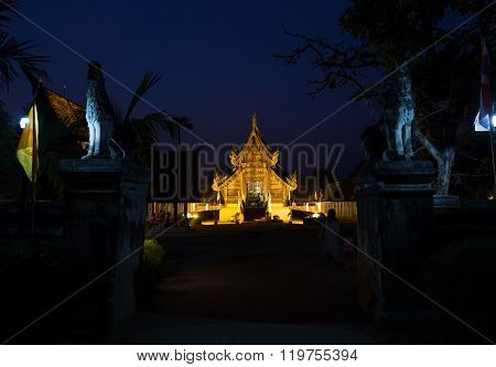 CHIANG MAI, THAILAND - FEBRUARY 22: light of ancient wooden buddhist church in Magha Puja Day at Intrawart temple in Chiang Mai, Thailand on February 22, 2016.