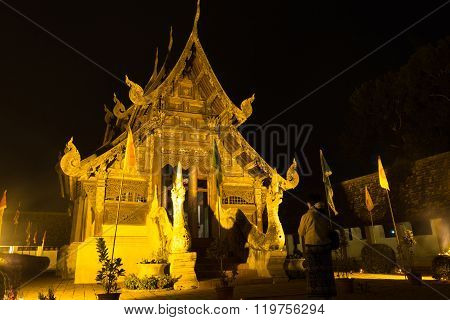 CHIANG MAI, THAILAND - FEBRUARY 22: woman pay respect to buddhism church in Makha Bucha Day or Tabaung Full Moon Day at Intarawart temple in Chiang Mai, Thailand on February 22, 2016.