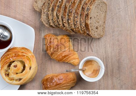 Cup Of Coffee With French Croissant With Chocolate Served