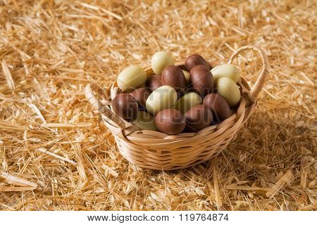 Easter Chocolate Eggs In A Small Basket