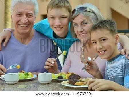 Grandparents with grandchildren at breakfast