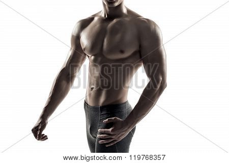 Strong man showing perfect body, abs and chest. Close-up