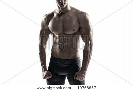 Strong man showing perfect abs, houlders, biceps, triceps and chest