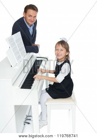 Teacher and student at piano