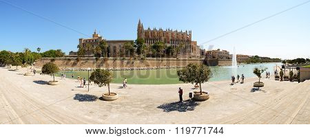 Mallorca, Spain - May 30: The Tourists Are Near Cathedral Of Santa Maria Of Palma On May 30, 2015 In