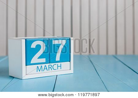 March 27th. Image of march 27 wooden color calendar on white background.  Spring day, empty space fo