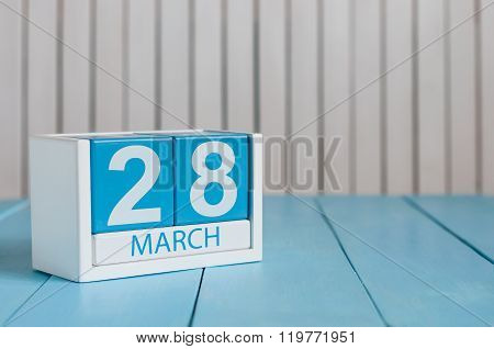 March 28th. Image of march 28 wooden color calendar on white background.  Spring day, empty space fo