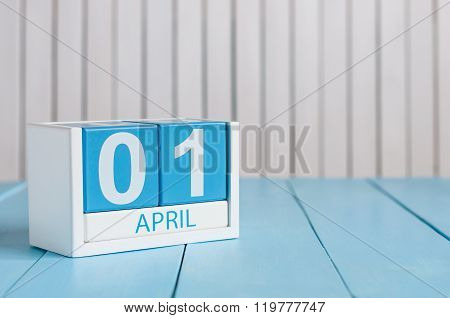 April 1st. Image of april 1 wooden color calendar on white background.  Spring day, empty space for